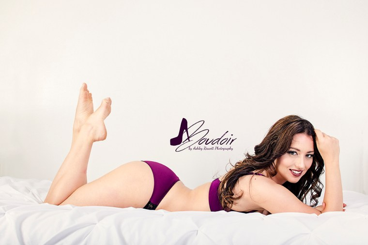 woman in purple underwear on bed