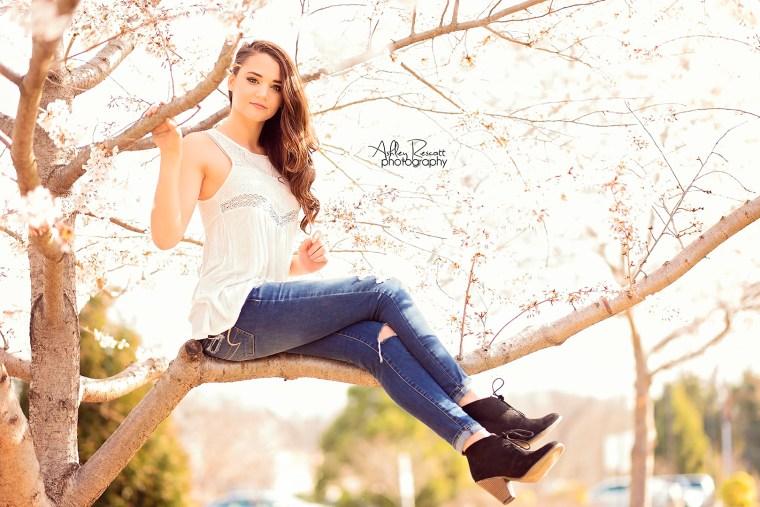 high school senior girl in cherry blossom tree
