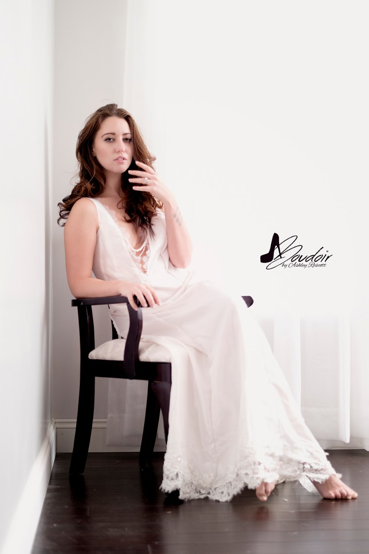 woman sitting in white bridal dressing gown
