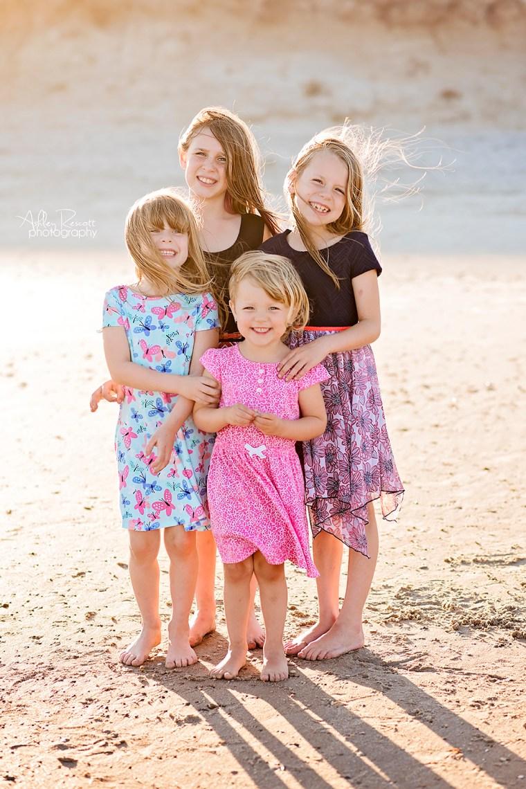 four sisters on beach