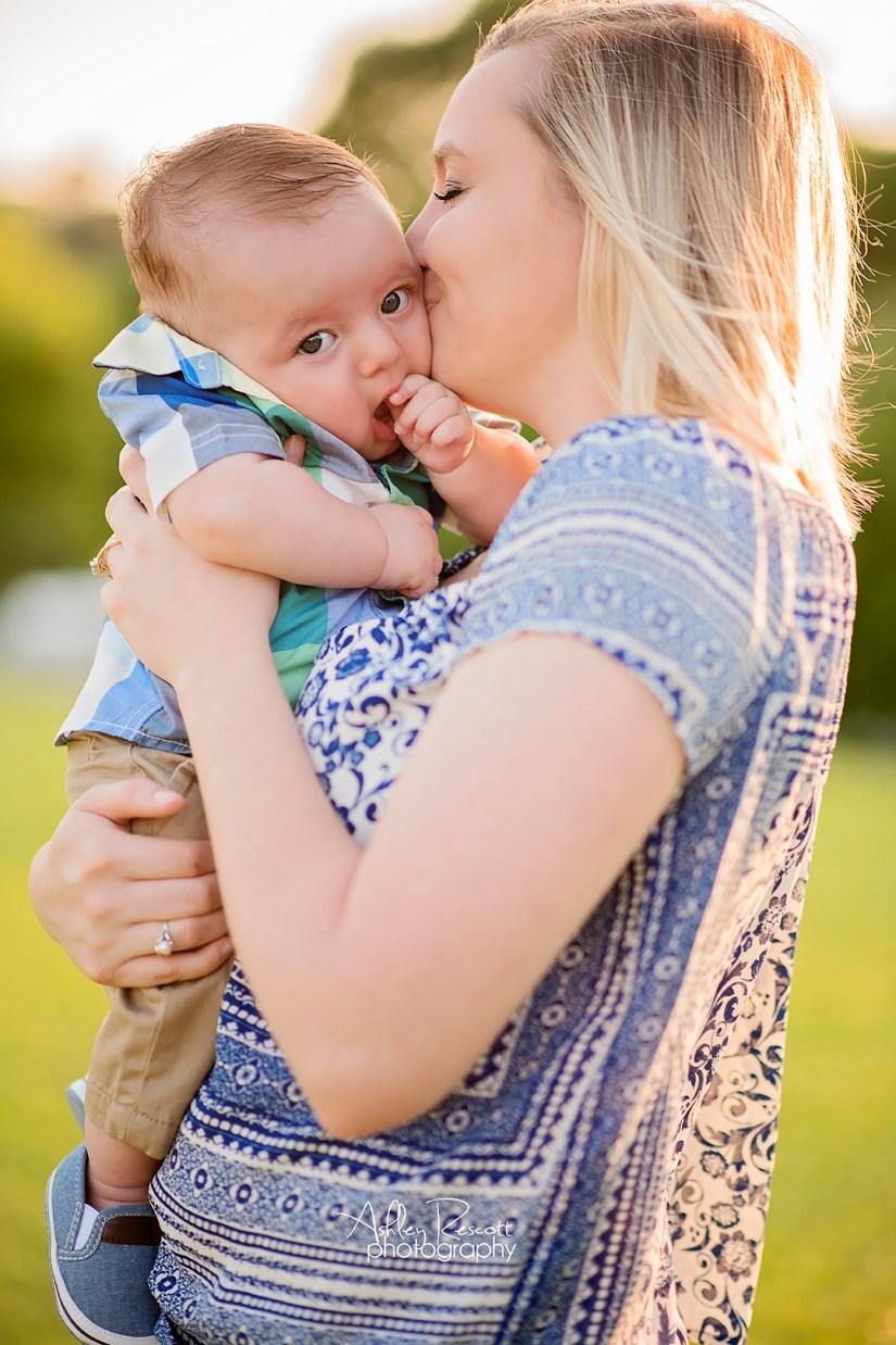 mom holding infant son