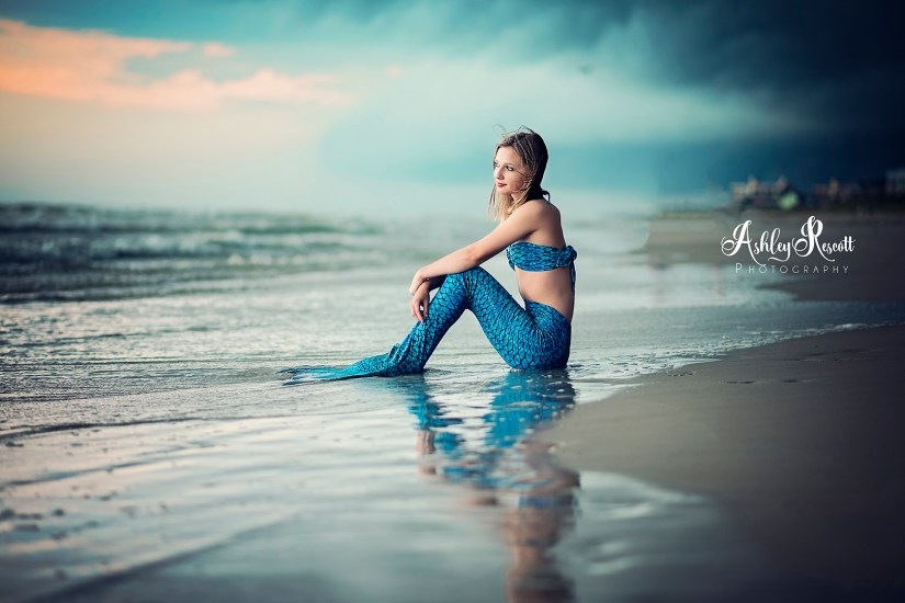 mermaid on beach with stormy skies