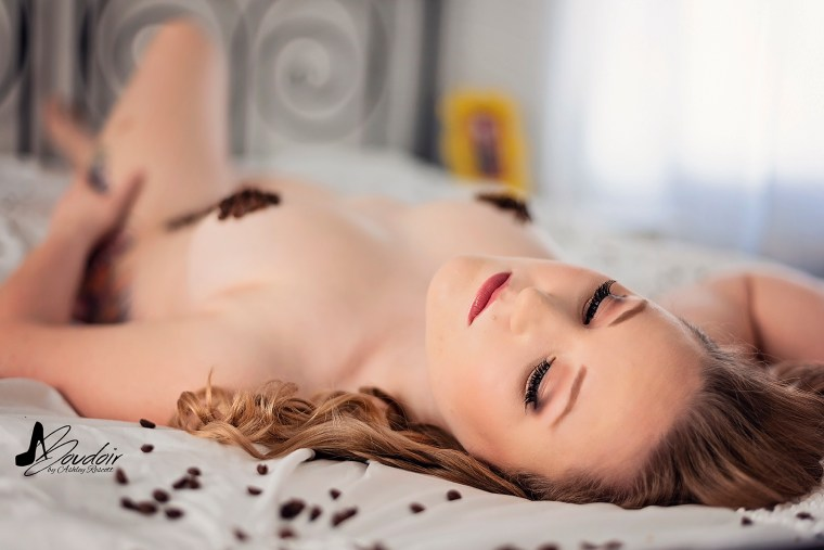 woman lying in bed with coffee beans