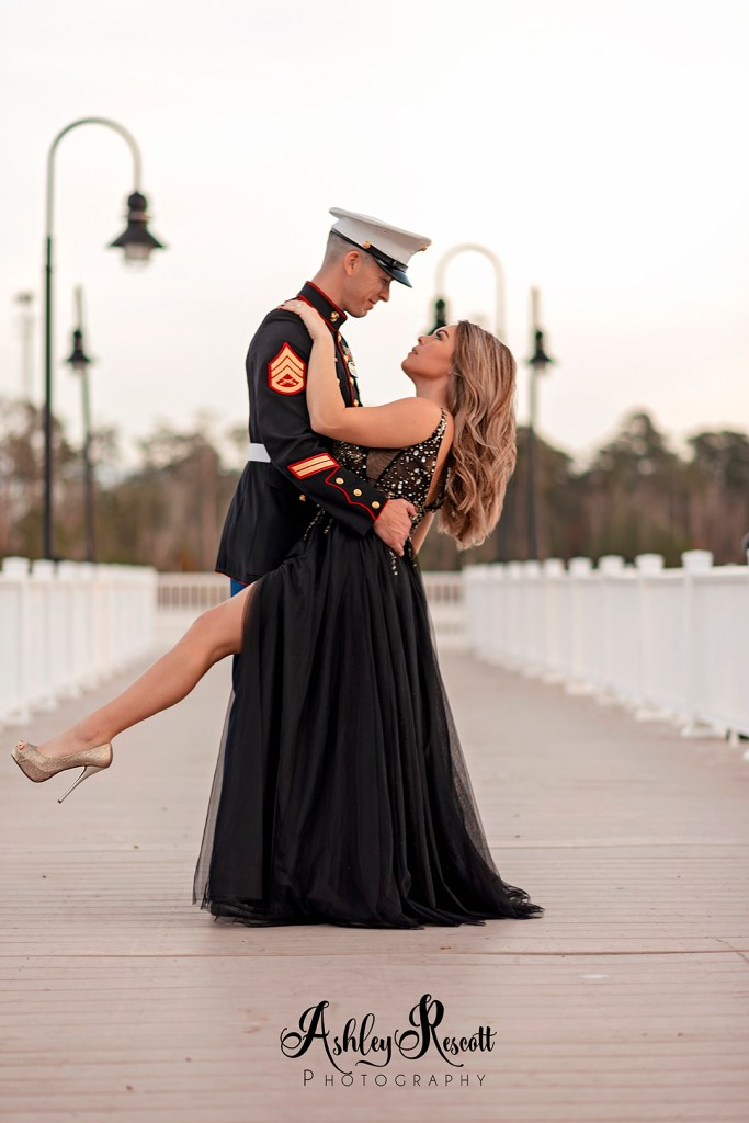 Marine dancing with his wife on pier