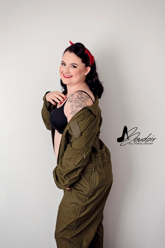 pin up in red headband and flight suit