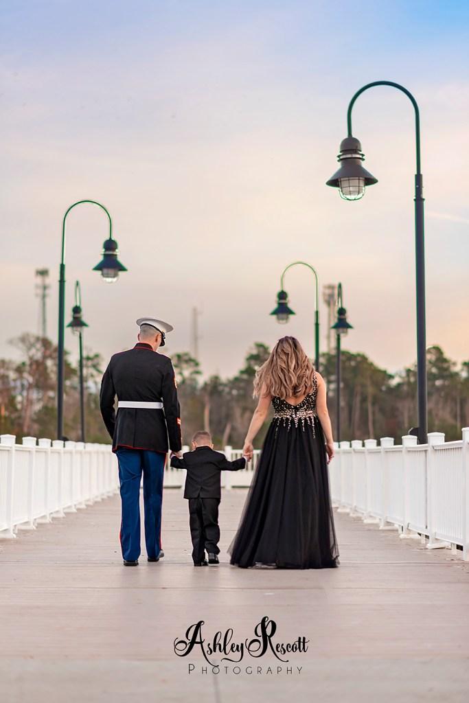 Marine family walking away into sunset