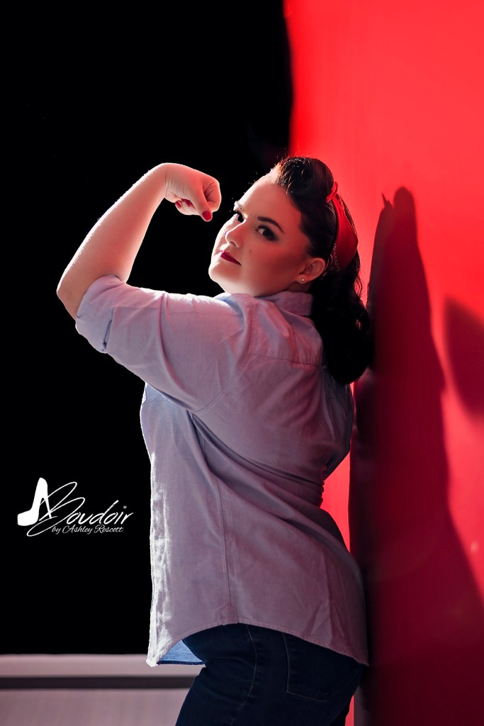 pin up on red wall and wearing a man's shirt