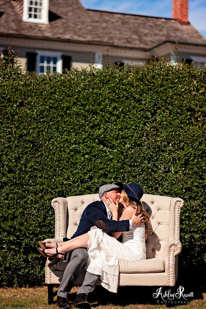 couple kissing on couch outside