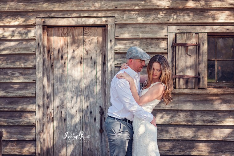 Man grabbing his bride to be's tushy in front of a cabin