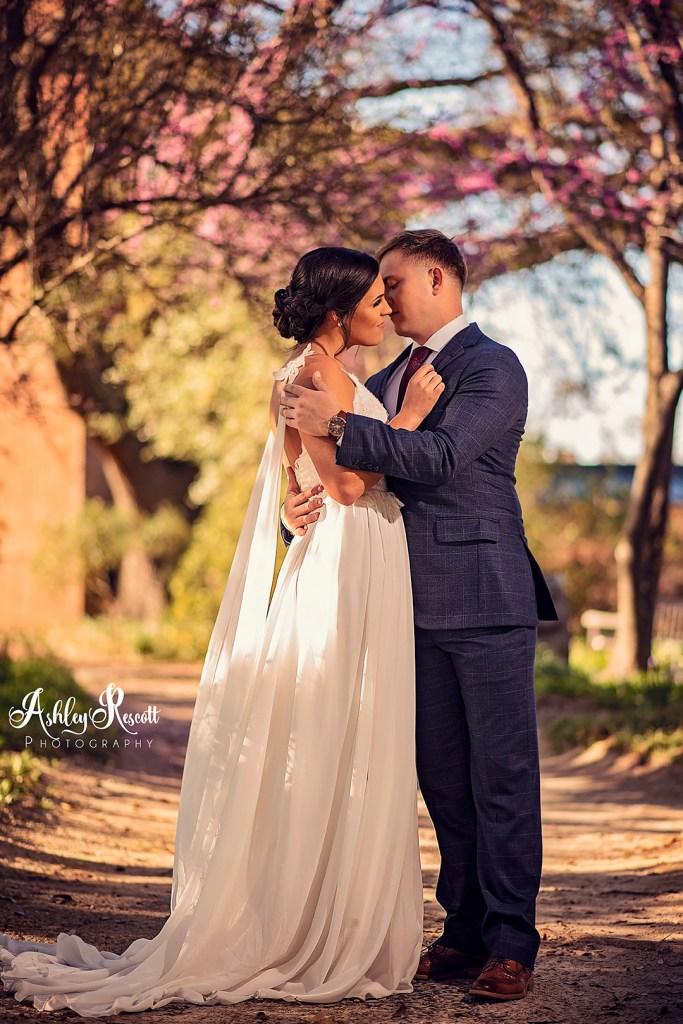 bridal couple in garden pathway