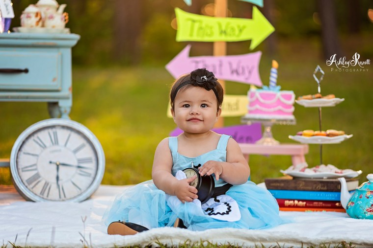 smiling baby holding clock