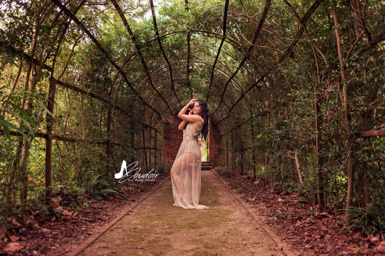 woman in pleached allee