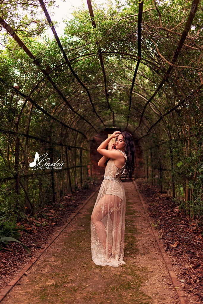 woman standing in pleached allee