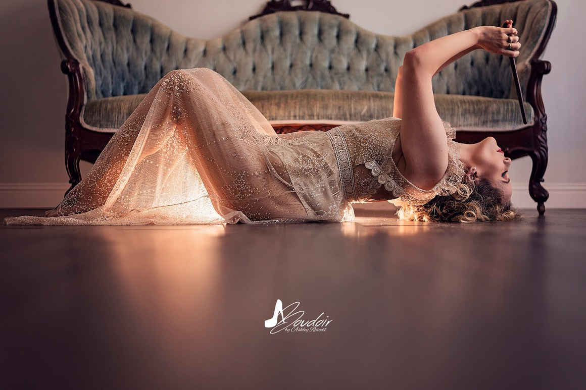 woman arching with wand in front of couch