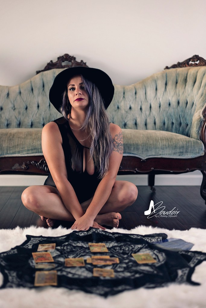 woman sitting on floor with tarot cards