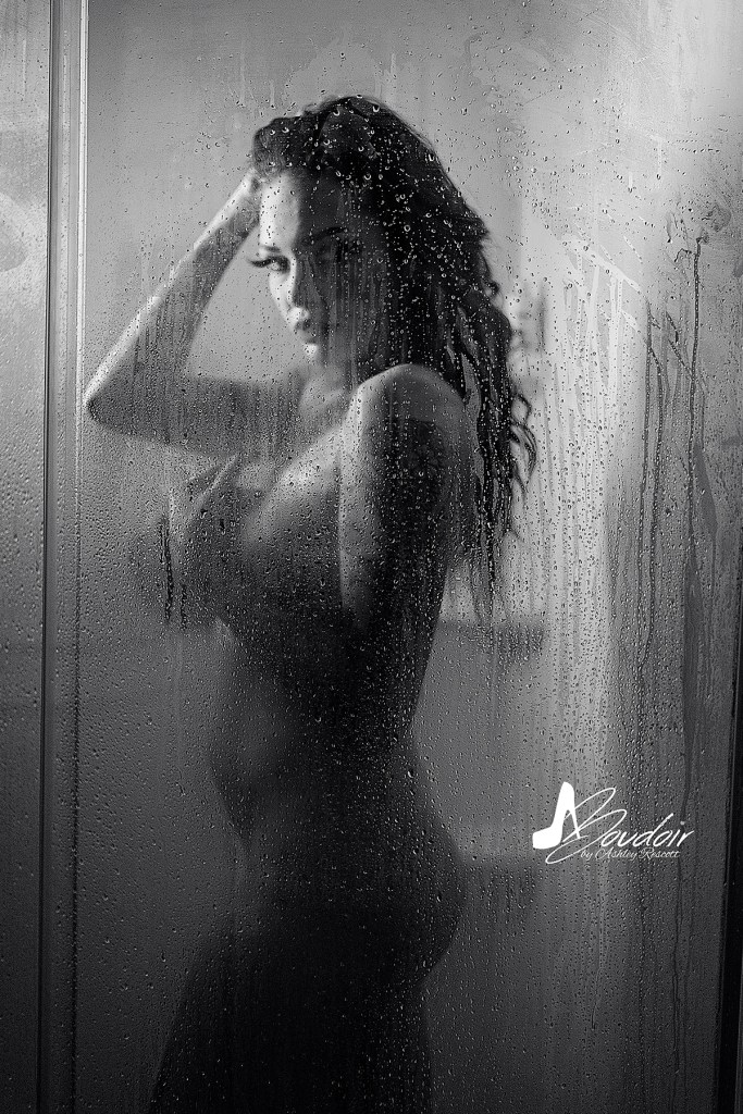 black and white image of woman in shower