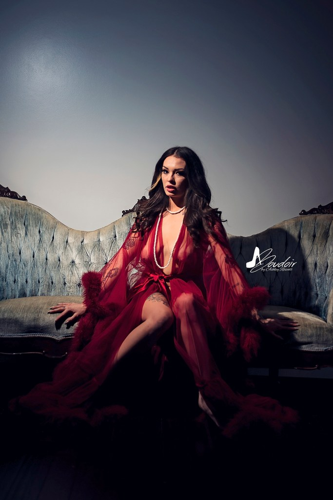 woman in red robe on couch