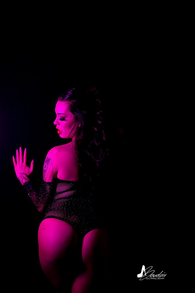 woman from behind, neon boudoir