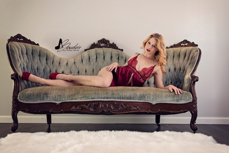 woman in red lingerie lounging on blue couch