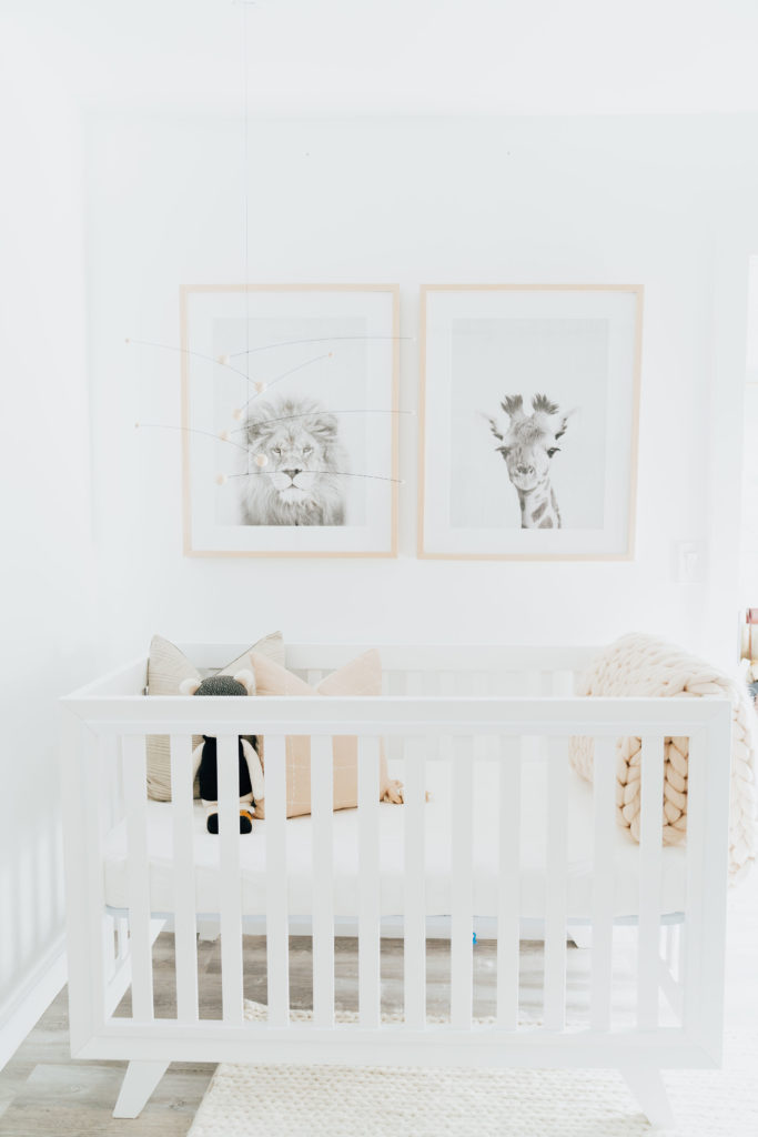Baby Boy Nursery ideas featured by top Los Angeles life and style blogger, Ashley Hodges: white baby crib, animal prints above the crib