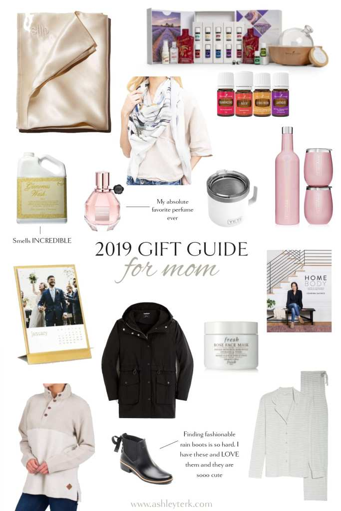 Gift Guide: Top 20 Thoughtful Christmas Gifts for Moms by popular North Carolina life and style blogger, Ashley Terk: collage image of brass easel and calendar, Winesulator and Set of Two 14ox Tumblers, Herringbone Loop Pullover, Young Living Starter Kit and Diffuser, Revlon One-Step Hair Dryer & Volumizer Hot Air Brush, YETI 14oz Stainless Steel Vacuum Insulated Mug with Lid, UGG Women's Ansley Moccasin, Glam Wash Laundry Detergent, Chantal Vintage Tea Kettle, Flowerbomb Eau de Parfum Spray, Silk Pillowcase, Custom Cutting Board, J.Crew Perfect Rain Jacket,  Royal Craft Wood Luxury Bathtub Caddy Tray with Bonus Free Soap Holder, and Bath Bombs Gift Set.