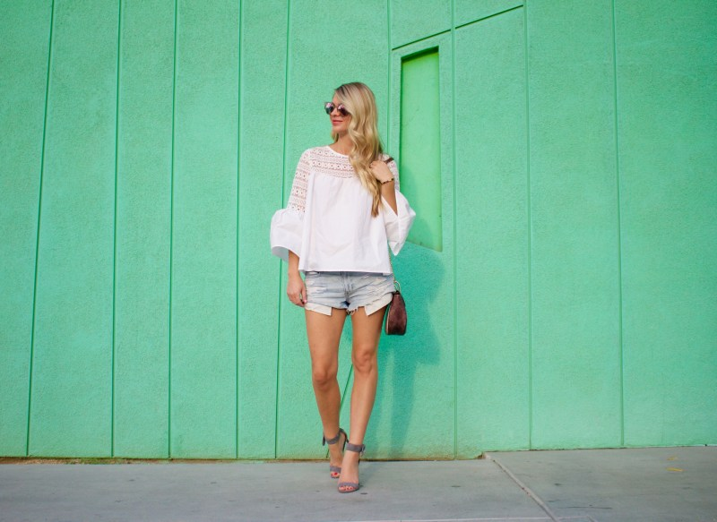white bell sleeved top
