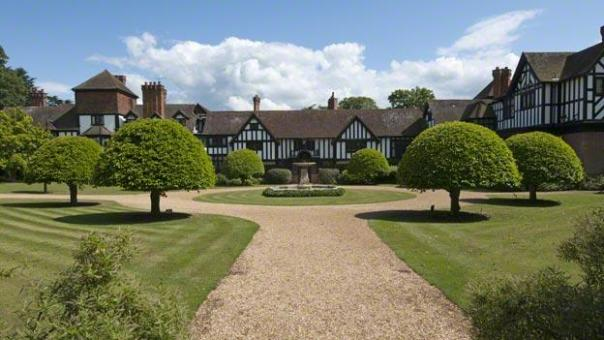 Topiary trees and fountain at the front of Ascott, Buckinghamshire.