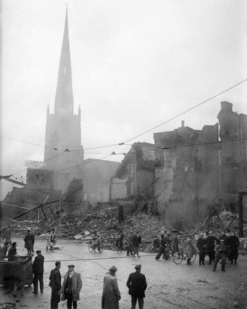 Holy Trinity Church after the air raid on the night of 14-15 November 1940. Photo - Taylor - War Office official photographer. From the collections of the Imperial War Museums