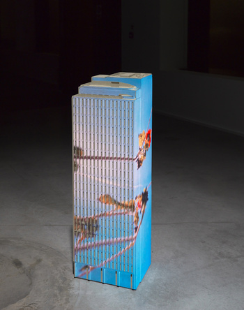 Stone Skyscraper, 2014. Video object; miniturized skyscraper carved from sandstone with a video projected on the facades, silent. 103 x 30 x 26.6 cm / 40 1/2 x 11 3/4 x 10 1/2 in