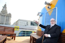 Sir Peter Blake on the Dazzle Ferry Snowdrop at Liverpool Pier Head. Photo: Liverpool Echo