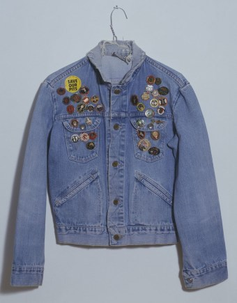 Jeremy Deller: Jacket from The Battle of Orgreave Archive (An Injury to one is an Injury to All), 2001. Wall painting, paint on fibreboard, vinyl text, map, books, jacket, shield, printed papers, 2 videos and audio video, projection, colour and sound, 62 mins