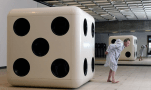 """Searle almost does himself a mischief during an encounter with a giant dice. Photograph: Christian Sinibaldi for the Guardian"""