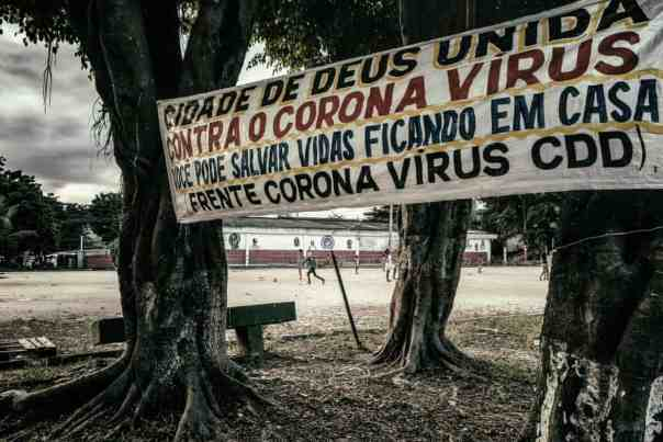 In City of God, a banner from a local group urges people to stay at home. Photograph: Nicoló Lanfranchi/The Guardian