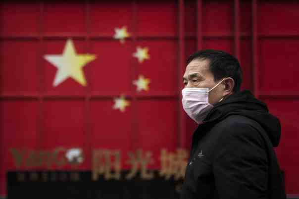 A man in Wuhan on 10 February, the 19th day of the transport lockdown. Photograph: Getty Images