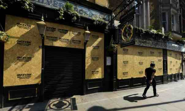 A boarded-up pub in London, 9 April 2020: 'Exceptionalism lies behind the assumption that there was something peculiarly unnatural in expecting Brits to obey drastic restrictions.' Photograph: James Veysey/REX/Shutterstock