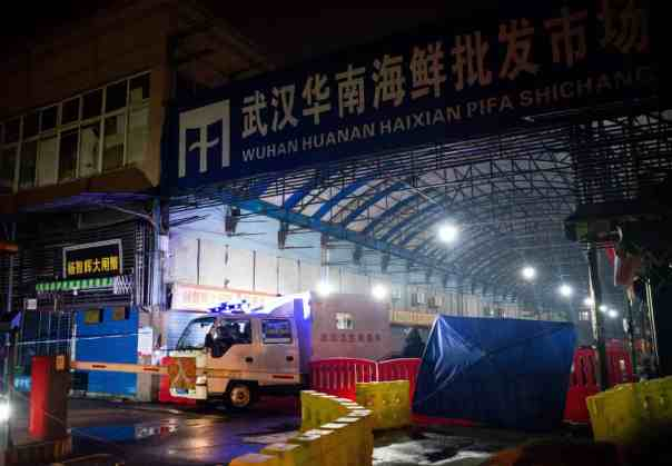 The Wuhan hygiene emergency response team leave the closed Huanan seafood wholesale market on 11 January. Photograph: Noel Celis/AFP via Getty Images