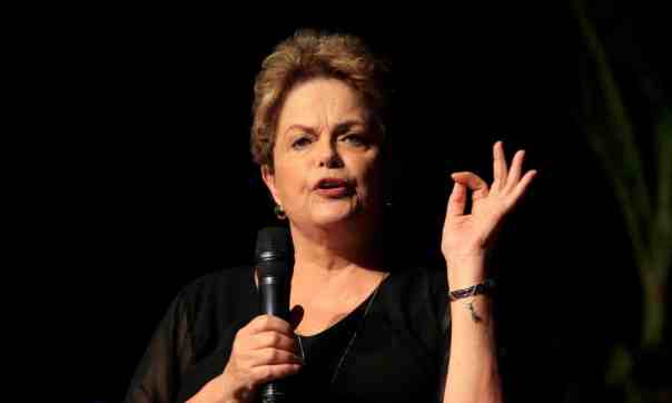 Dilma Roussefff told the Guardian: 'We are adrift on an ocean of hunger and disease … It truly is an utterly extreme situation that we're witnessing in Brazil.' Photograph: Ricardo Maldonado Rozo/EPA