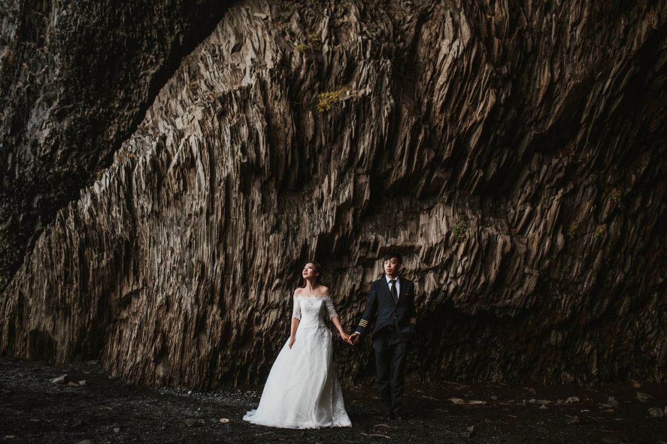 Iceland wedding photographer photographing couple in cave in Iceland