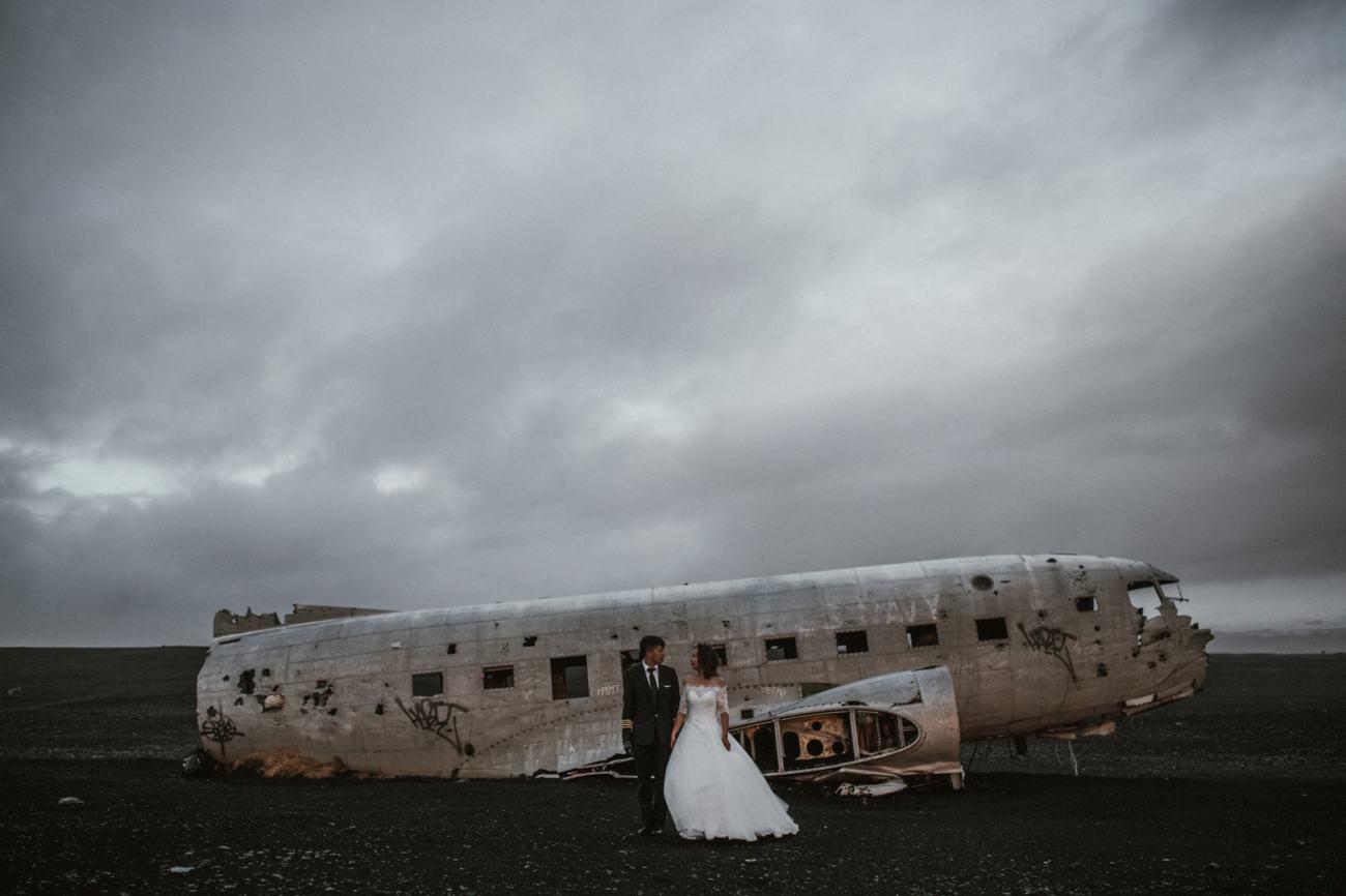 Iceland plane wreck on black sand beach wedding
