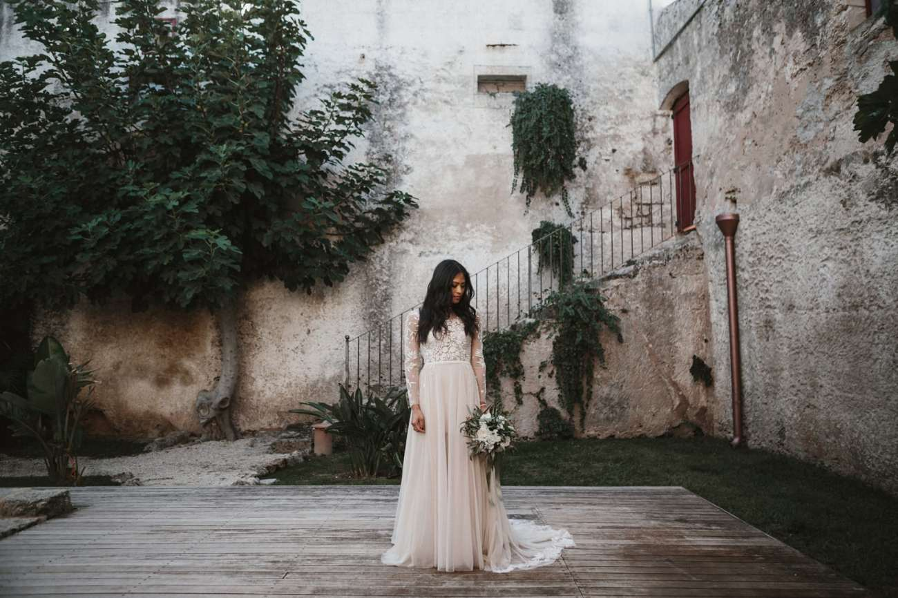 Bride wearing hermione de paula gown at Puglia Wedding