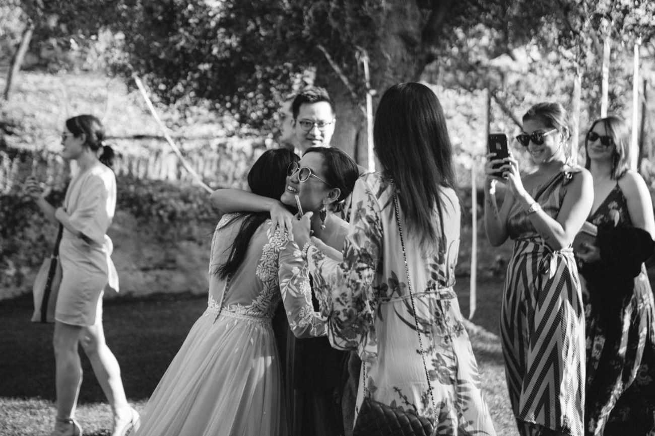 Hugging the bridge at italian wedding reception