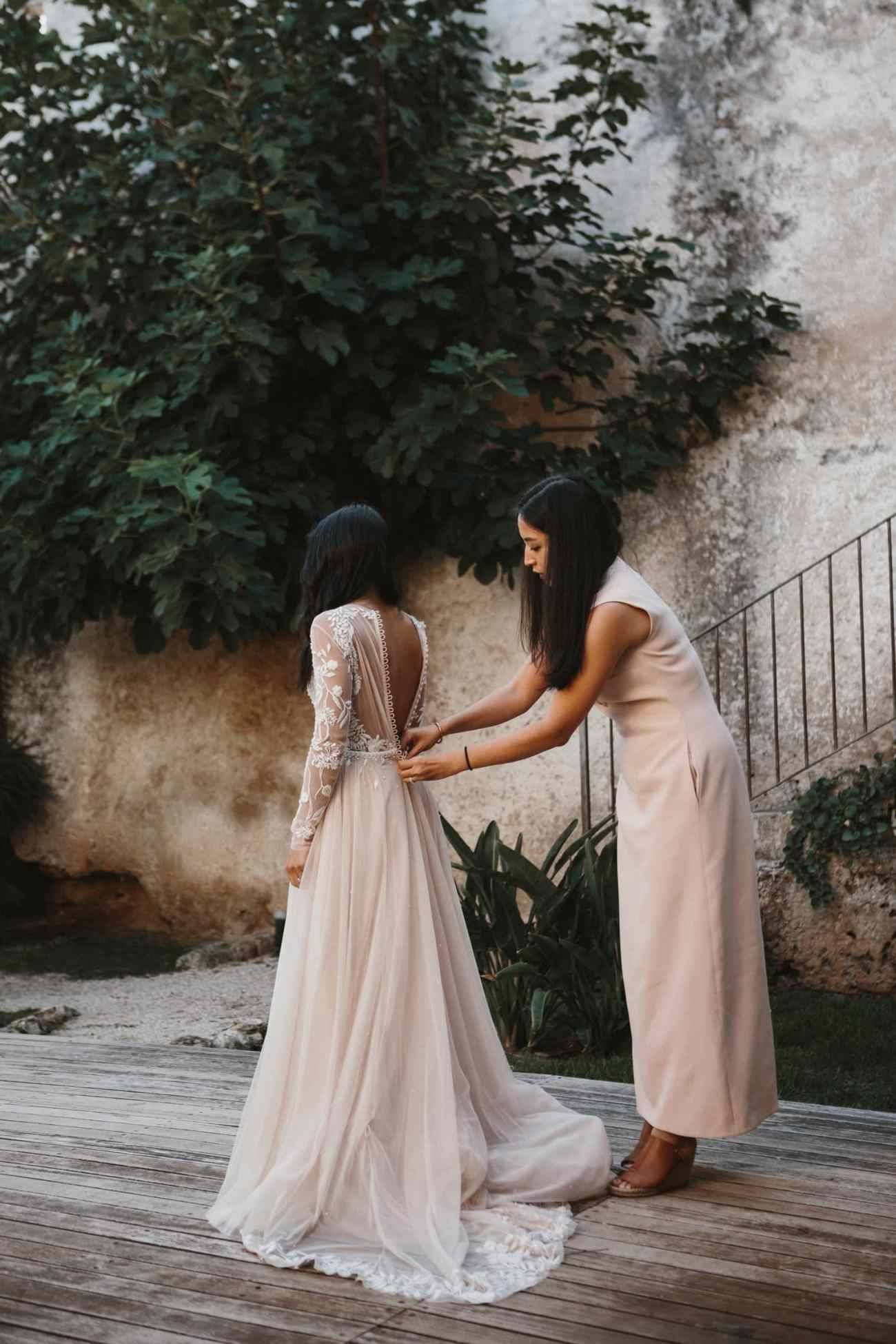 Bride wearing Hermione de Paula gown for her destination wedding in italy