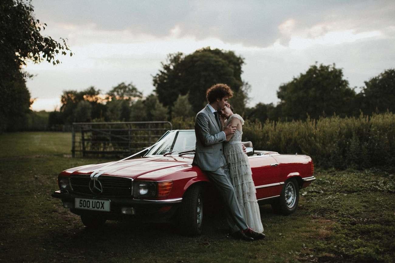 bride and groom and vintage wedding car outside of their Canterbury Barn Wedding