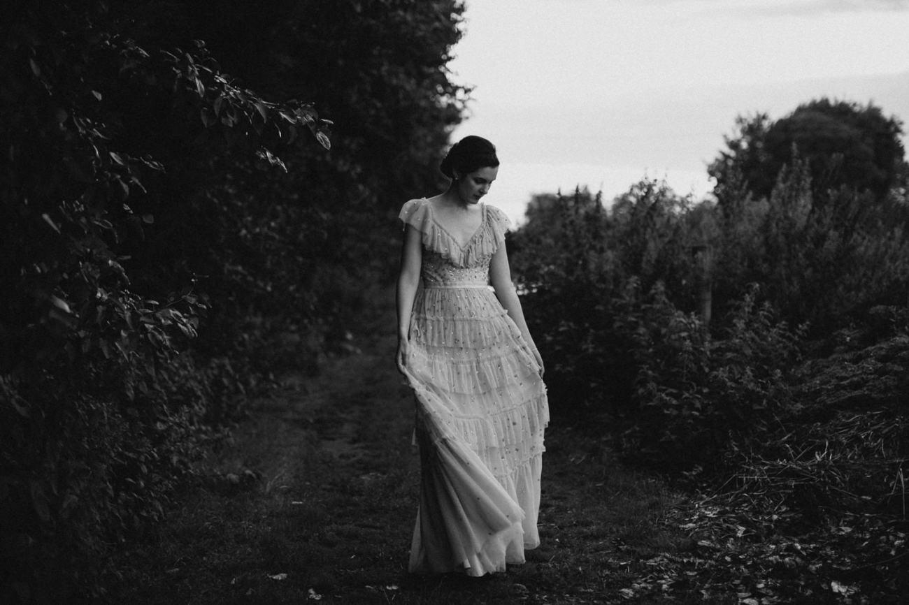 bride wearing beautiful Needle and Thread wedding dress