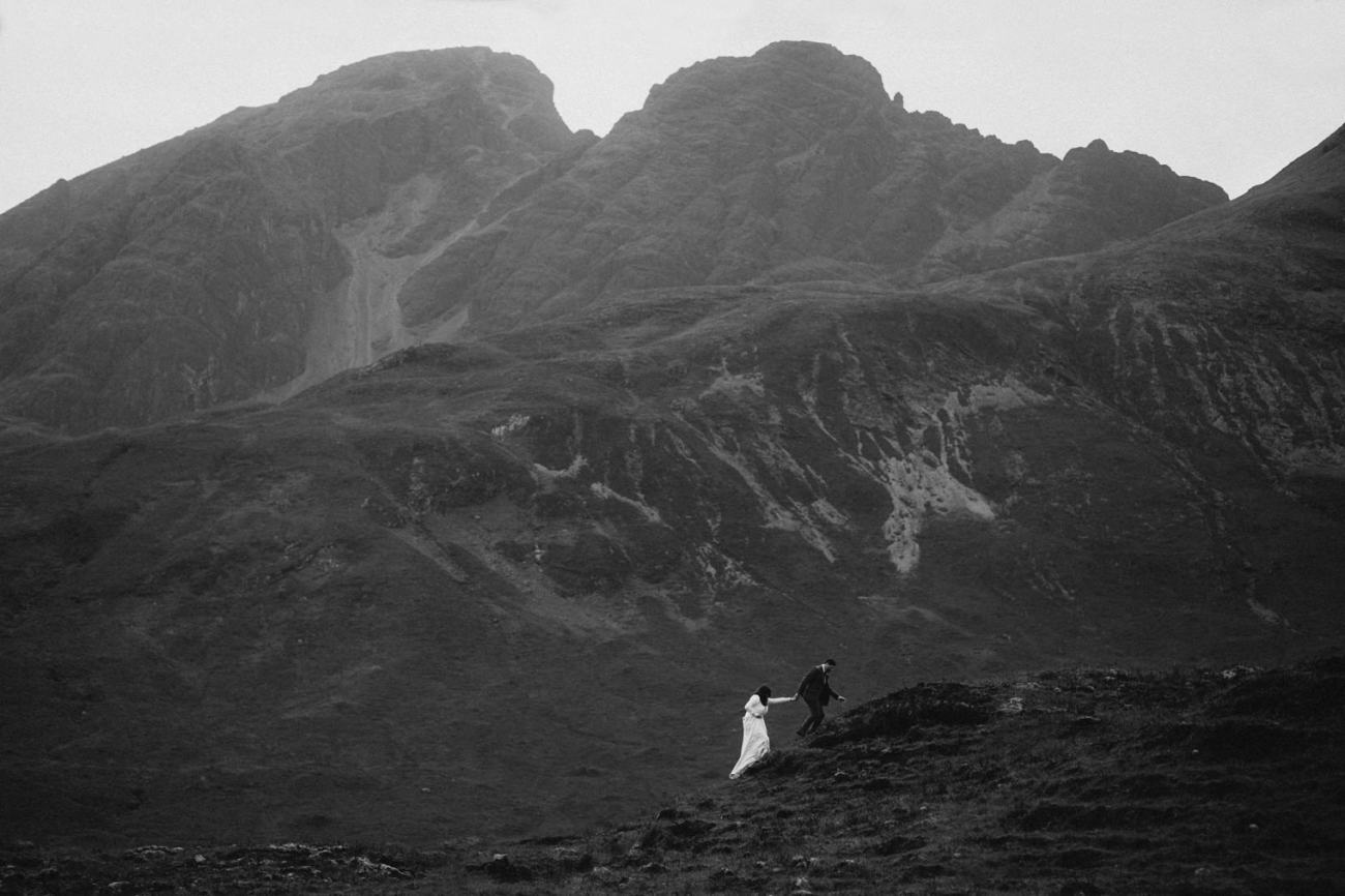 Bride and groom eloping in Isle of Skye with the Cuillin mountains in the background