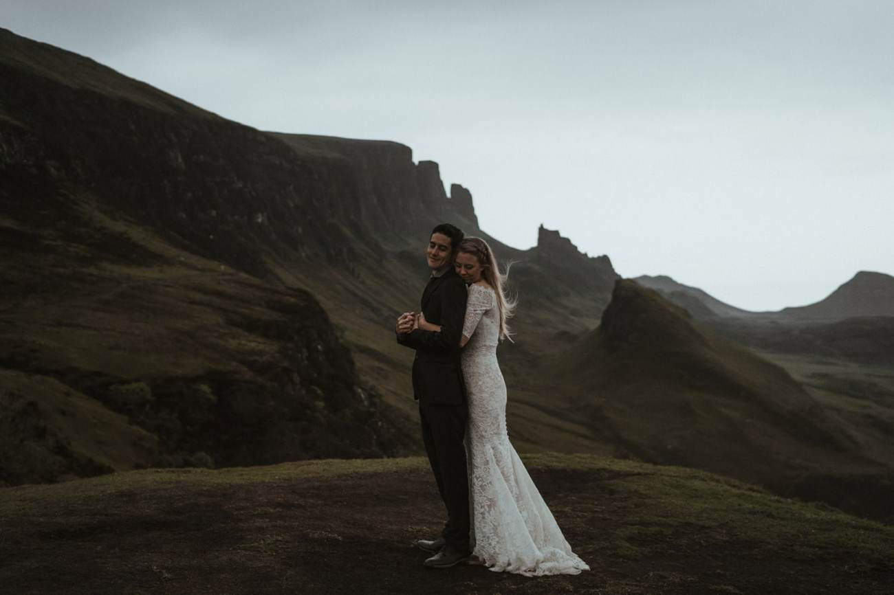 Bride hugging groom at the Quiraing during their elopement in Scotland