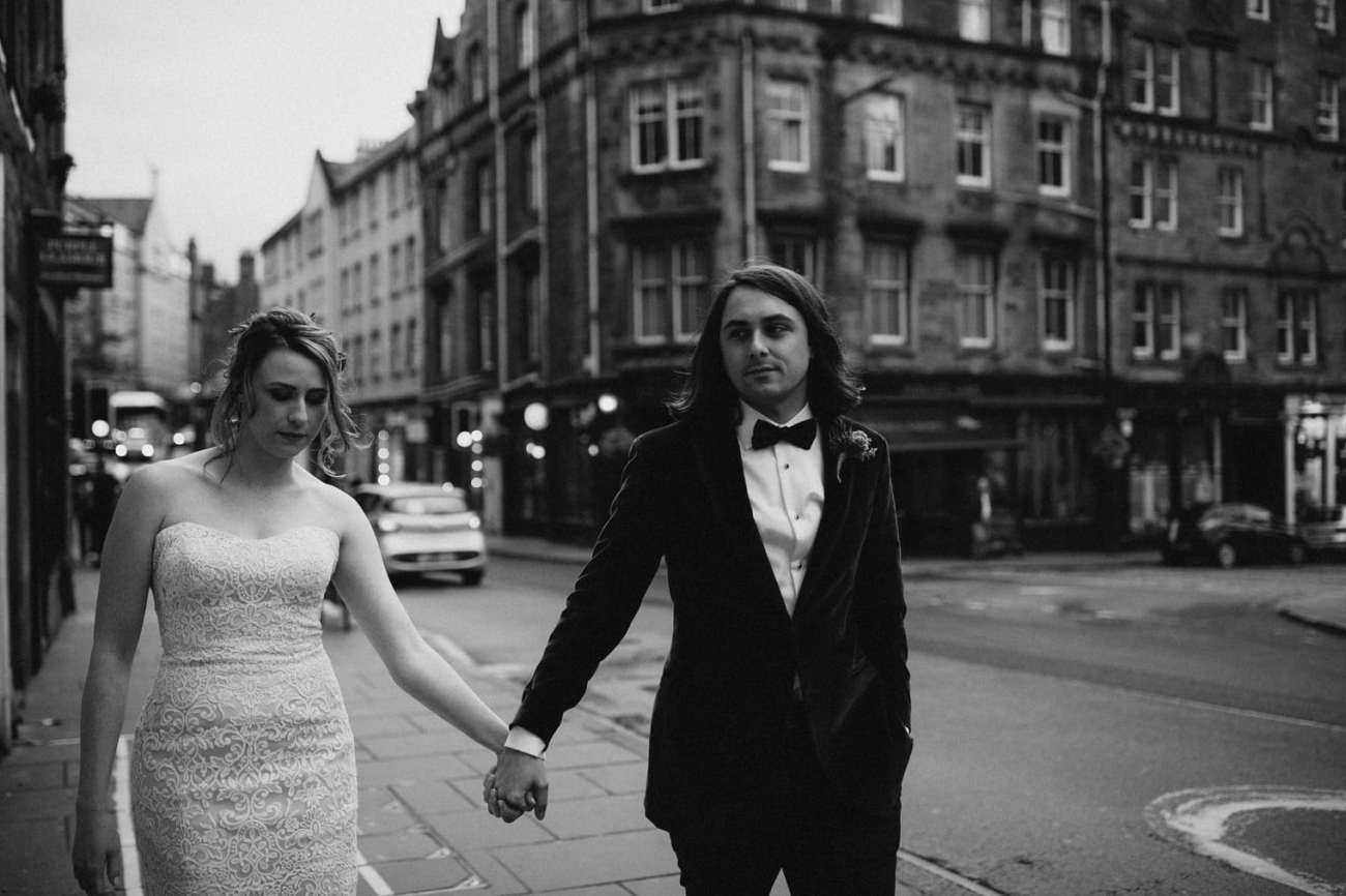 newlyweds walking through the streets during their Edinburgh Elopement