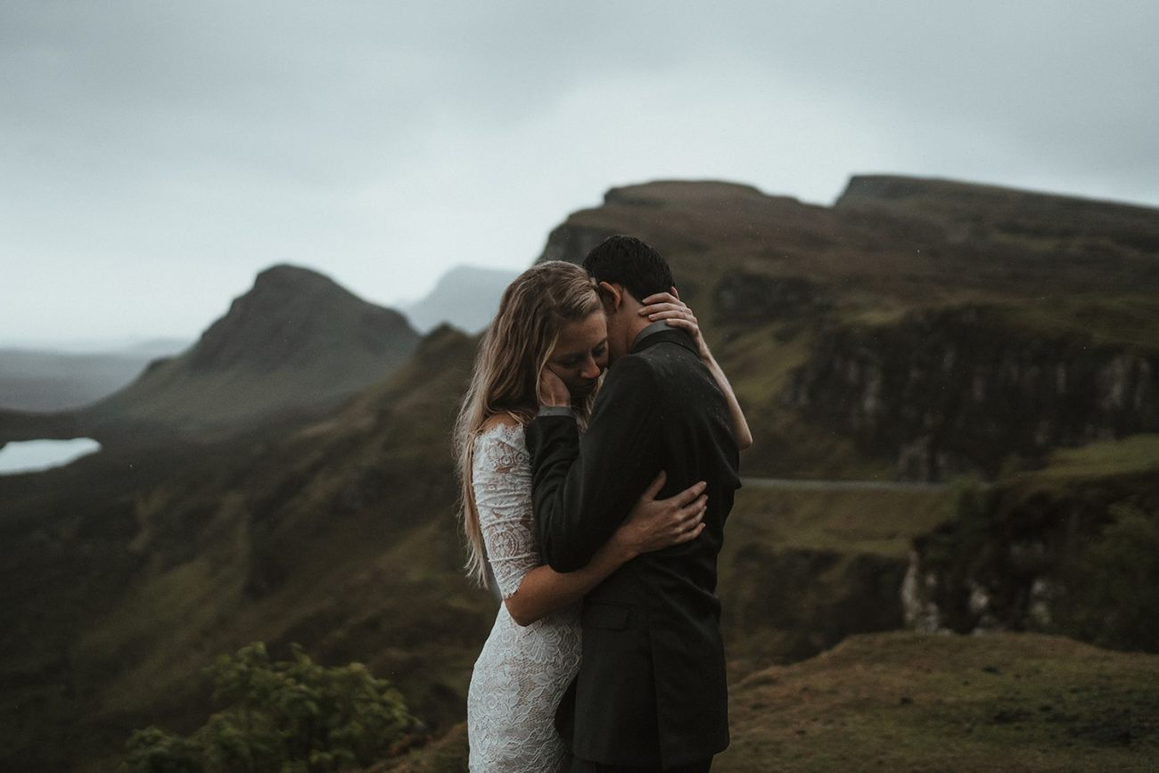 Couple eloping at the Quiraing in Scotland in the rain