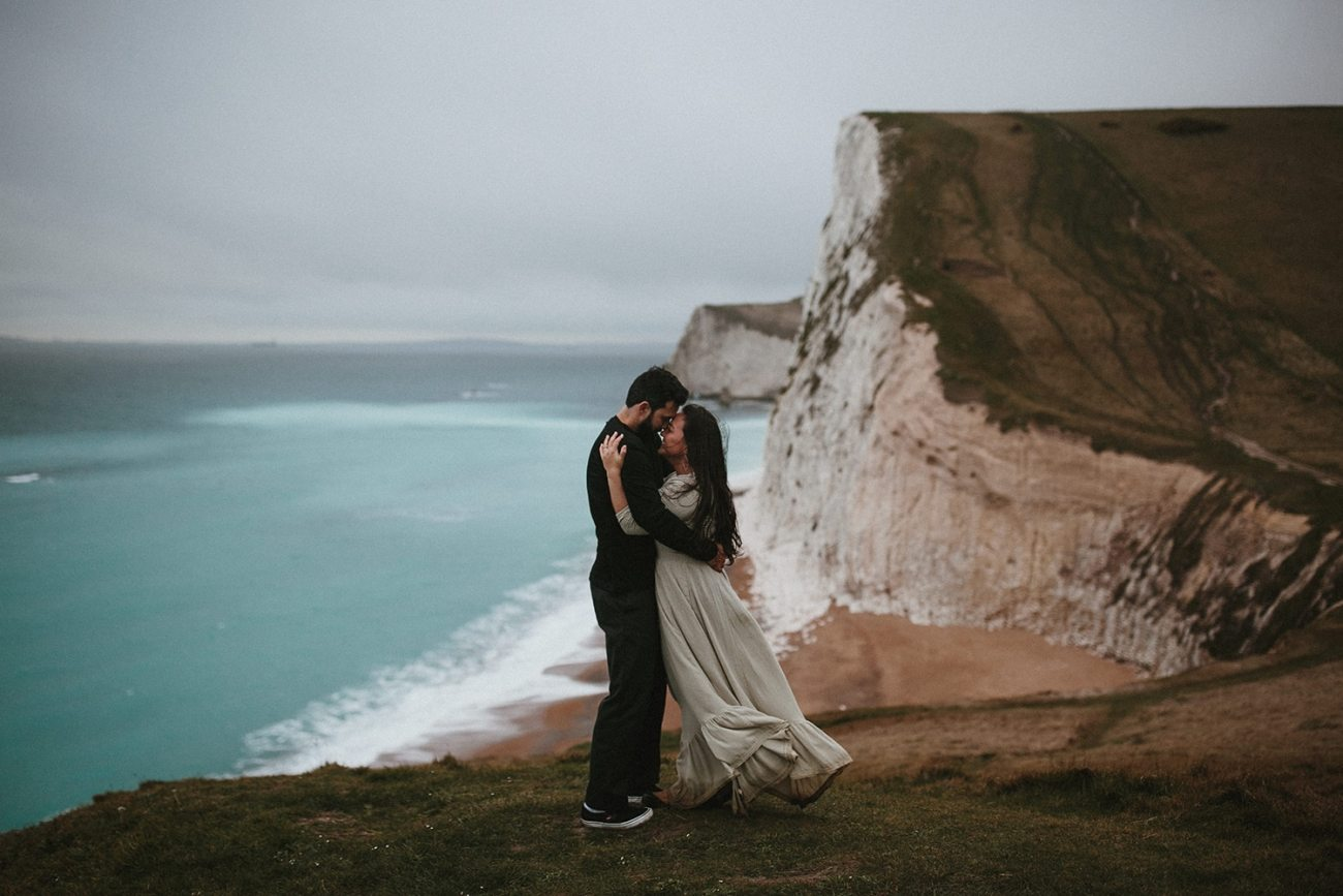 Couple hugging each other at Durdle door during engagement session