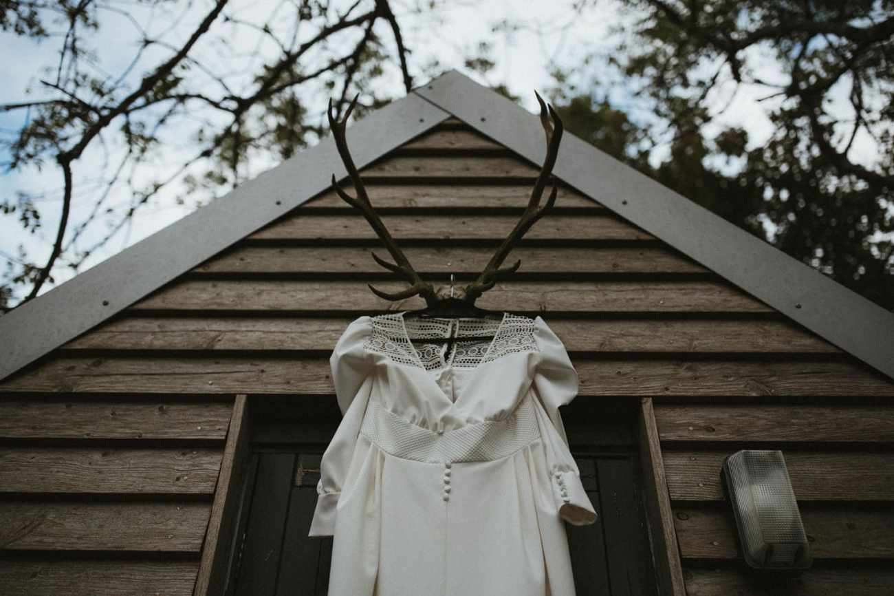 Vasiliki Couture wedding dress hanging on stag horns